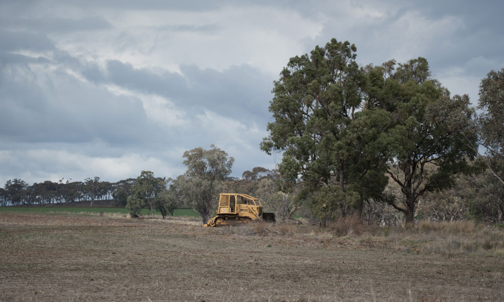 Stationery bulldozer in front of trees near Inverell, NSW © WWF-Aus / Adam Krowitz