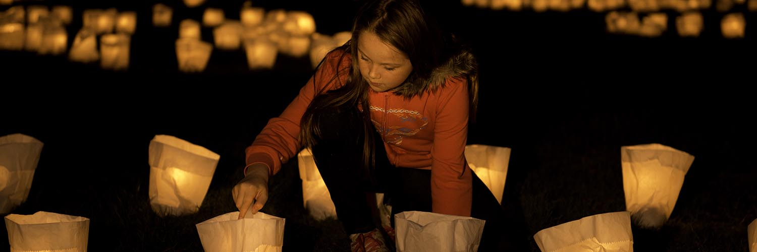 Harmony Austin lighting a candle at the Candle Installation by Jorge Pujol © Michael Mulrine / WWF-Aus