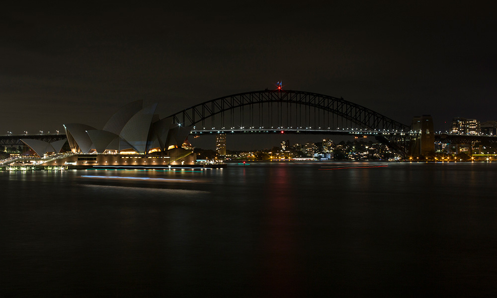 View of the Harbour Bridge and Opera House from Mrs Macquaries Chair, NSW, before the lights are switched off to celebrate 10 years of Earth Hour © WWF-Aus / Quentin Jones