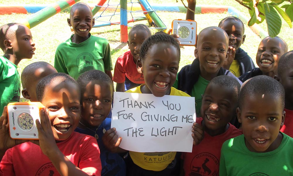 School kids from Ghana with their Solar Buddy lights © SolarBuddy.org
